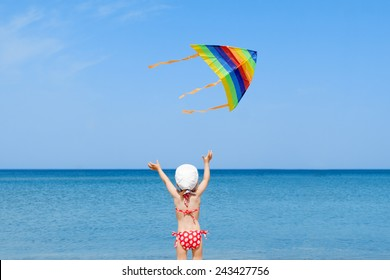 beach kid girl kite flying outdoor coast shore unrecognizable