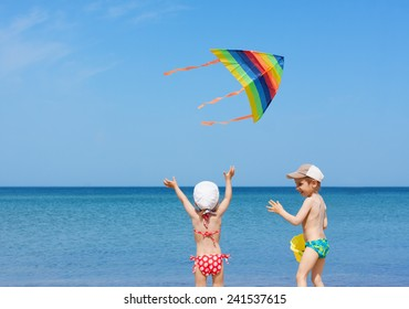 beach  kite fly children siblings play fun together