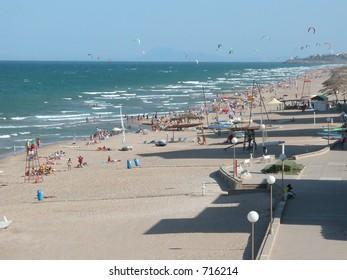 Beach with kite surfers on a sunny day (Valencia, Spain)