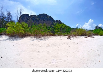 The beach of Koh Poda with the limestone cliff in the background, in the Ao Nang bay, Krabi province, Thailand