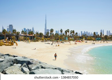 The beach of 'La Mer' (The Sea) with in the background the skyline of Dubai, United Arab Emirates