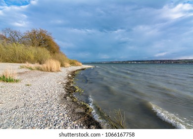 Beach at Lake Constance with storm clouds