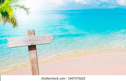 beach landscape with vintage wooden sign