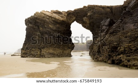 "Beach of ""Las Catedrales"", in Gijon (Spain). Picture of the great rock arch."