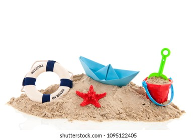 Beach with life buoy and toys in the sand isolated over white background