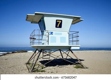 Beach lifeguard tower on the California coastline against blue skies