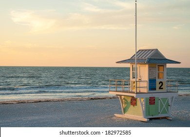 Beach lifeguard tower on a beach in Clearwater, Florida at sunset.