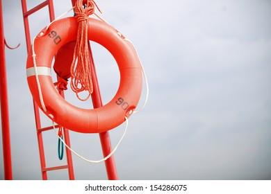 Beach life-saving. Lifeguard rescue equipment orange lifebuoy buoyancy aid