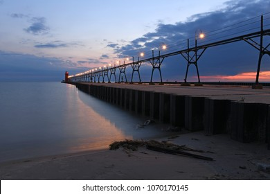 Beach and lighthouse in South Haven michigan at dusk