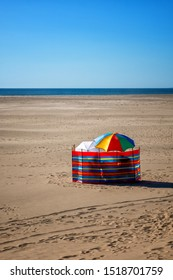 Beach like in the uk barmouth wales windbreaks and umbrellas