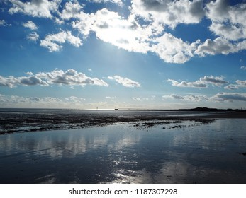 The beach at Littlehampton, West Sussex shelves gently towards the sea and at low tide the sky is reflected in the wet sand.