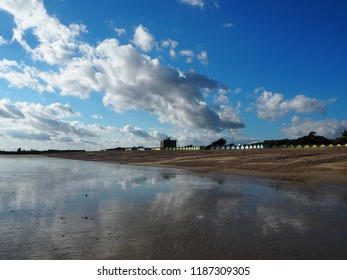 The beach at Littlehampton, West Sussex shelves gently to the sea and at low tide the sky is reflected in the wet sand.