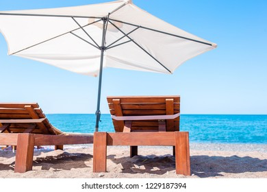 Beach lounge chairs on beautiful tropical beach