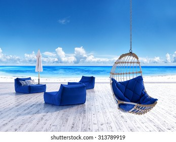 Beach lounge deck with sunbeds umbrella and hanging chair with sea view