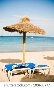 Beach loungers and umbrellas on the beach. Spain. Palma Mallorca