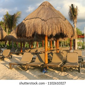 Beach loungers and umrellas on a tropical beach resort.
