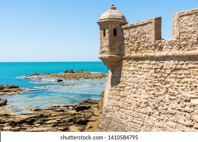 beach near the San Sebastian castle and the  in Cadiz  during a sunny day