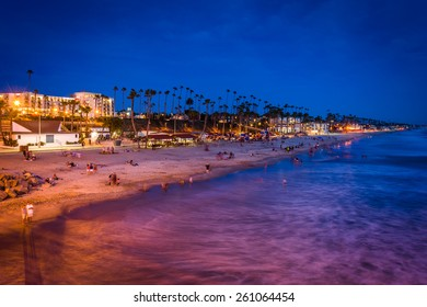 The beach at night, seen from the pier in Oceanside, California.