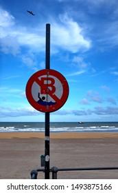 Beach of the North Sea. Sign: Swimming prohibited. Belgium.