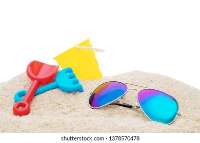 beach objects and sunglasses in the sand