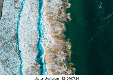 Beach, ocean and waves from above with beautiful colors and patterns