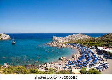 Beach off the coast of the island of Rhodes in Faliraki, Greece. Seaside landscape. Rocky coast and sea.Bay off the coast of faliraki on the rhodos.