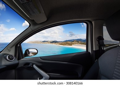 Beach on the coast viewed from inside a car