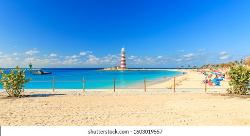 Beach on Ocean Cay Bahamas Island with a lighthouse and turquoise water