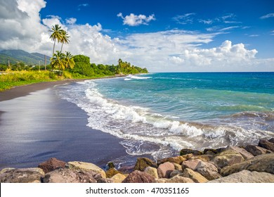 Beach on a St. Kitts island with black sand