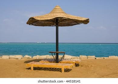 Beach on a sunny day. Hurghada city in Egypt.