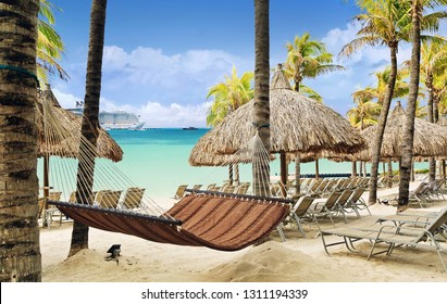 Beach on tropical resort with cruise ship in port