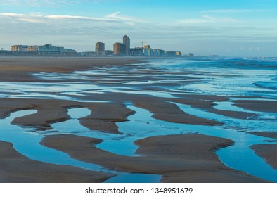 The beach of Ostend city and the North Sea at sunrise, Belgium.