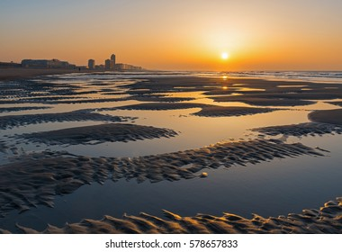 The beach of Ostend with sand ripples during sunset with the North Sea, Belgium.