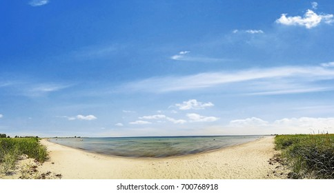 beach panorama - sand and ocean with blue sky