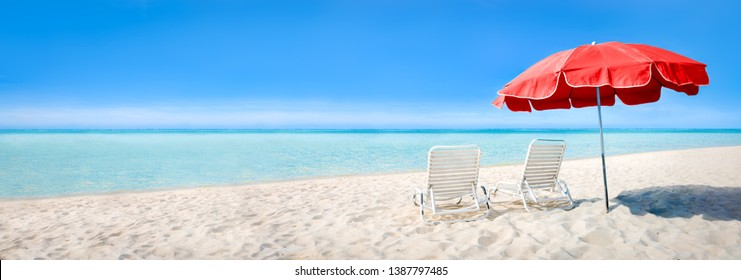 Beach panorama with sun chairs and parasol as background image