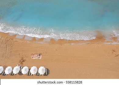 Beach with parasols top view in Antalya