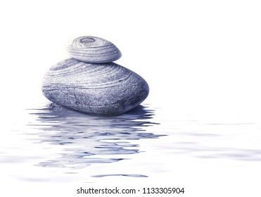 beach pebble pyramid in water