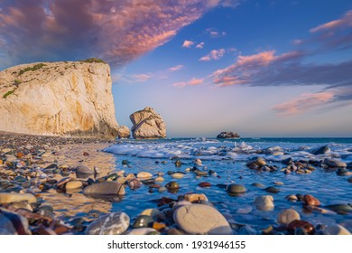 Beach Petra tou Romiou in Cyprus. Aphrodite Rock in Republic of Cyprus. Vacation in the village of Kouklia. Berig of the Mediterranean Sea. Beach near Aphrodite Rock. Travels to the Mediterranean Sea