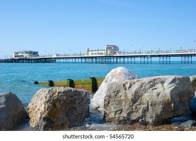 Beach with a pier in the distance