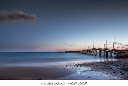 Beach with Pier and Sunset