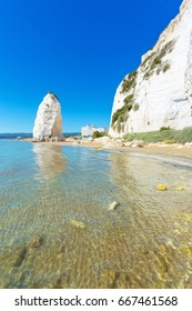 Beach of Pizzomunno rock, in Vieste, Gargano coast, Apulia, South of Italy