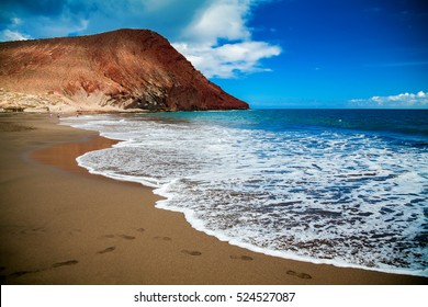 beach Playa de la Tejita with red mountain Montana Roja in the background, Tenerife Canary islands, Spain