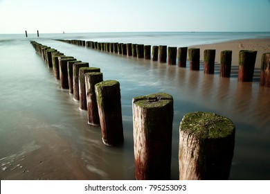 Beach poles on the beach of Domburg, Zeeland, the Netherlands,