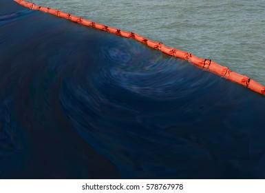 Beach pollution concept  .  A containment boom is a temporary floating barrier used to contain an oil spill. Booms are used to reduce the possibility of polluting shorelines and other resources.