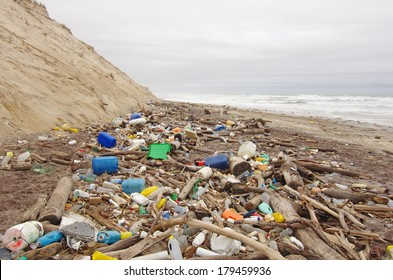 Beach pollution. garbage, plastic, and wastes on the beach after winter storms
