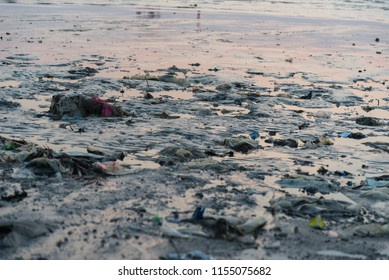 Beach pollution. Plastic bottles and other trash on the beach.