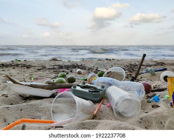 Beach pollution. Plastic bottles and other trash on sea beach. Ecological concept. earth day concept.globe pollution.