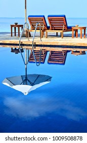 Beach pool in a tropical hotel with nice reflection
