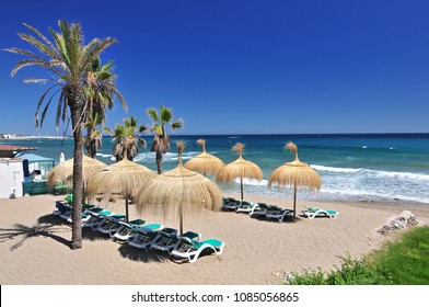 Beach in the popular resort of Marbella in Spain, Costa del Sol, Andalucia region, Malaga province.