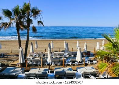 Beach in the popular resort of Marbella in Spain, Costa del Sol, Andalucia region, Malaga province.